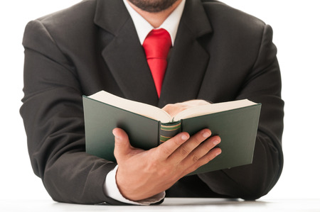 30437555 - business man wearing black suit and red tie reading a book