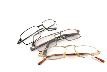 13395712 - three optical glasses over white