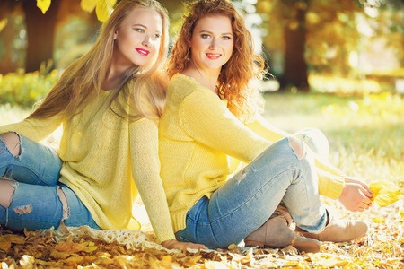 31810318 - two young girl in autumn forest