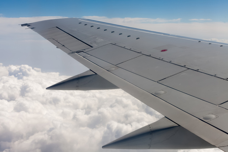 44880840 - beautiful view of airplane wing on blue sky background.