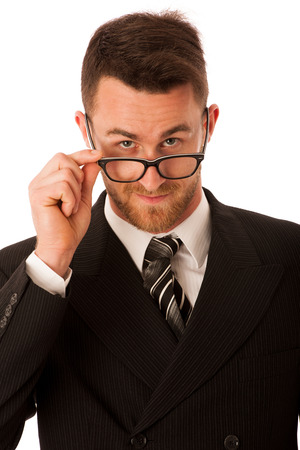 56633451 - successful businessman in formal suit looking over glasses isolated over white.
