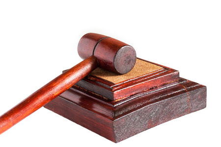53849988 - wooden gavel of judge, close-up, white background, no people, horizontal
